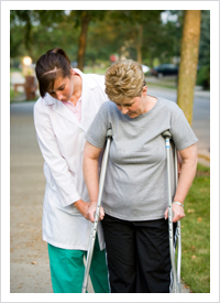 therapist helping patient with physical disabilities